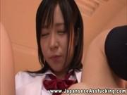 Oriental schoolgirl masturbates her asshole